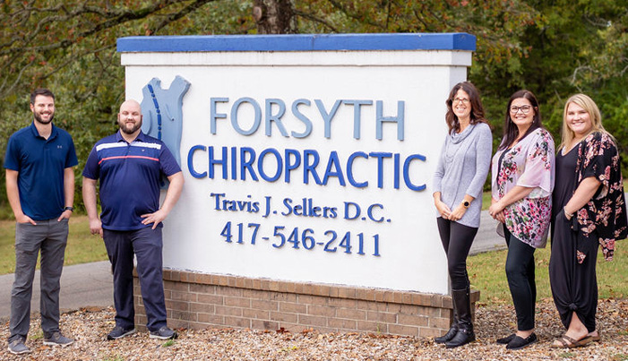 Chiropractor Forsyth MO Dr with Team